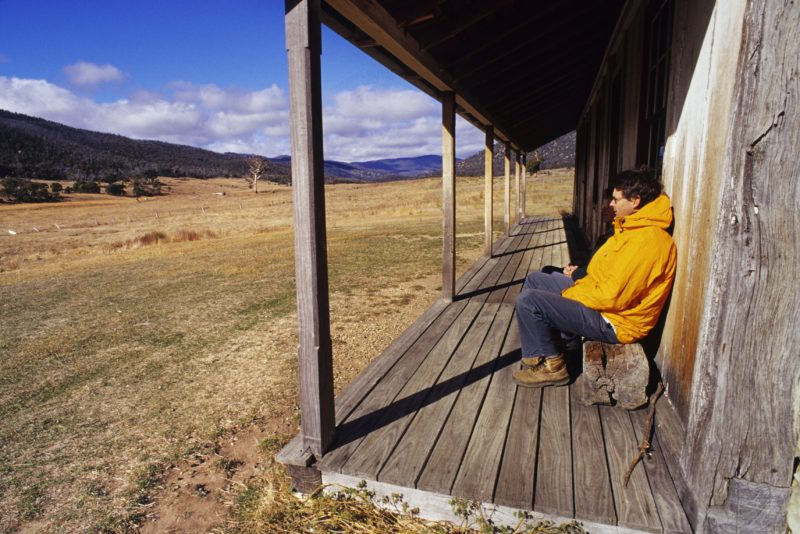 Hiker resting at Orroral Homestead