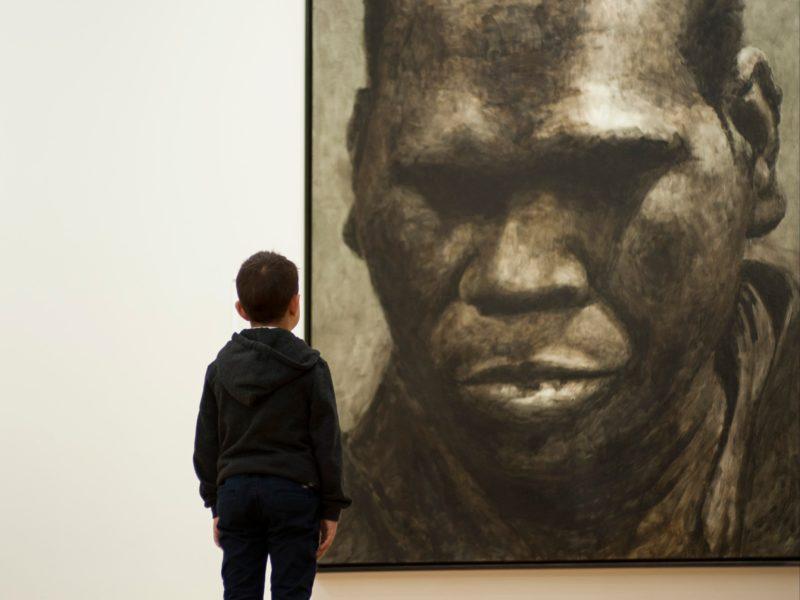 Child looking at Geoffrey Gurrumul Yunupingu