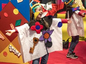 Child in costume performing at NGA Play