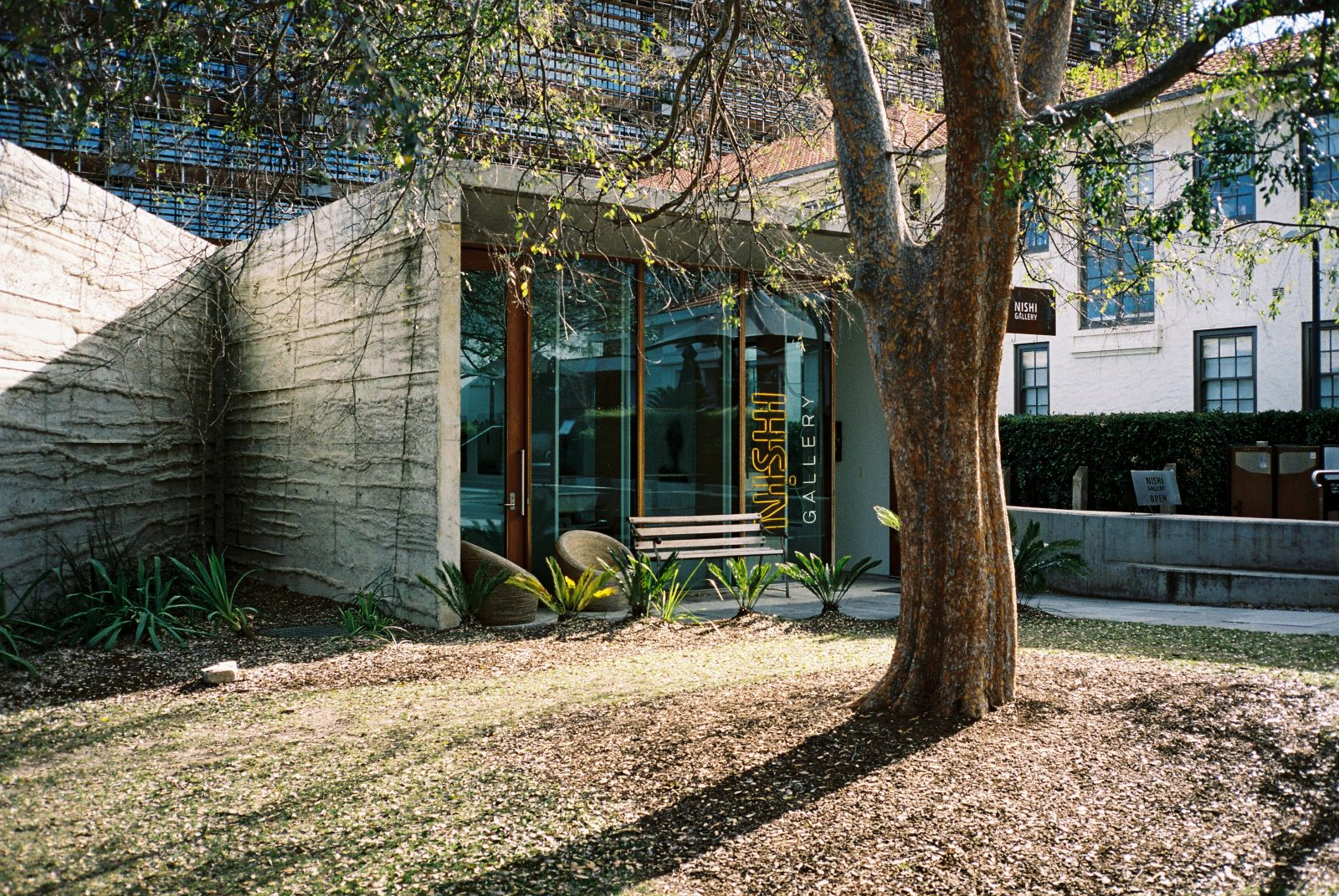 The exterior of Nishi Gallery. Surrounded by gardens.