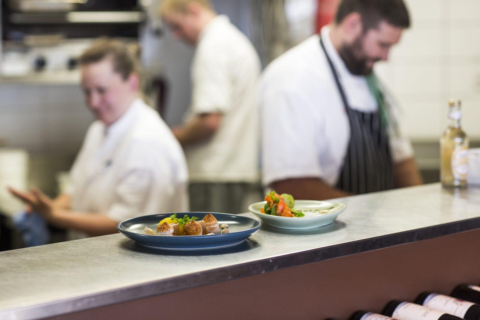 Plates on the kitchen pass
