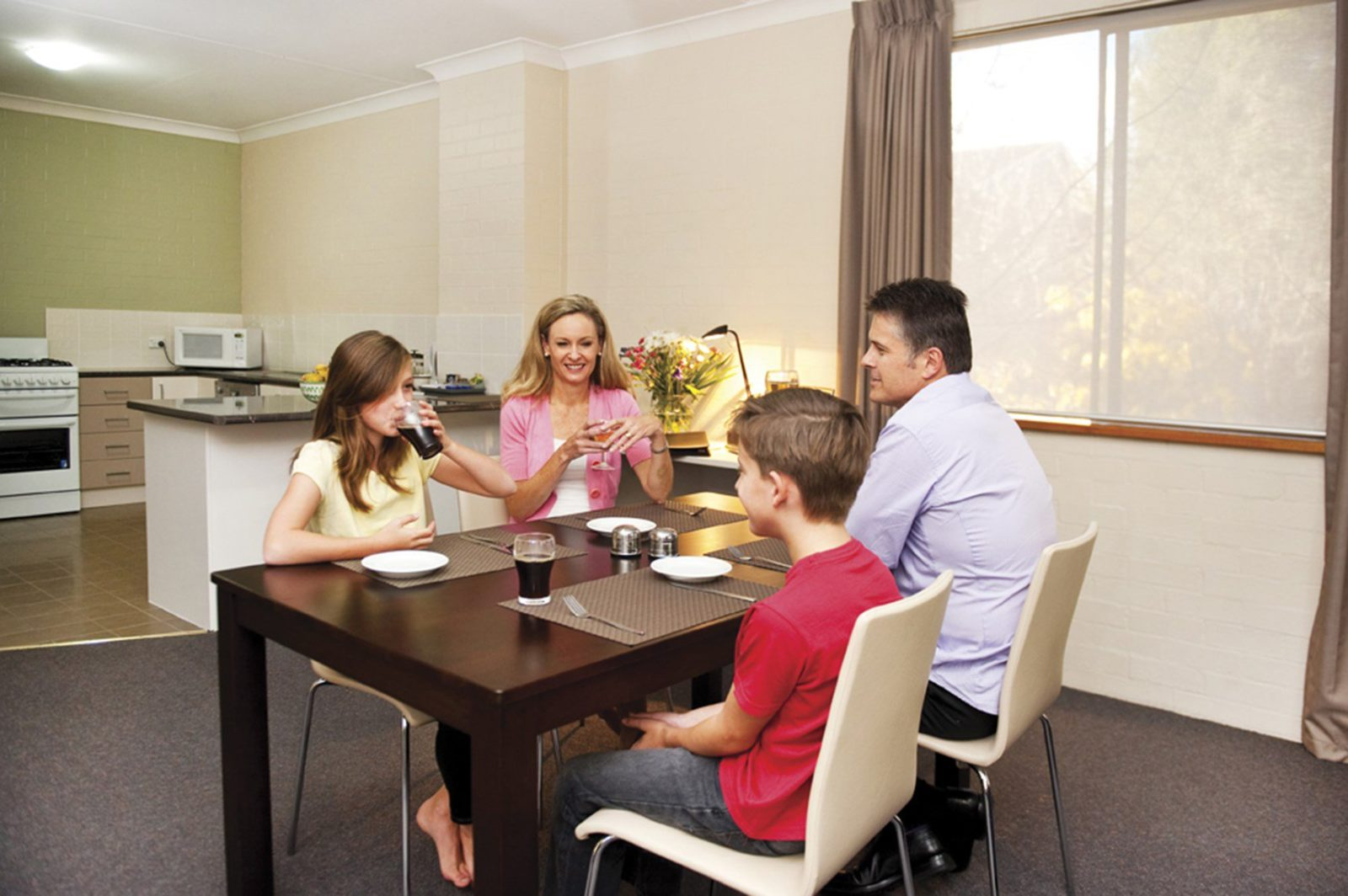 Family in the kitchen/dining area