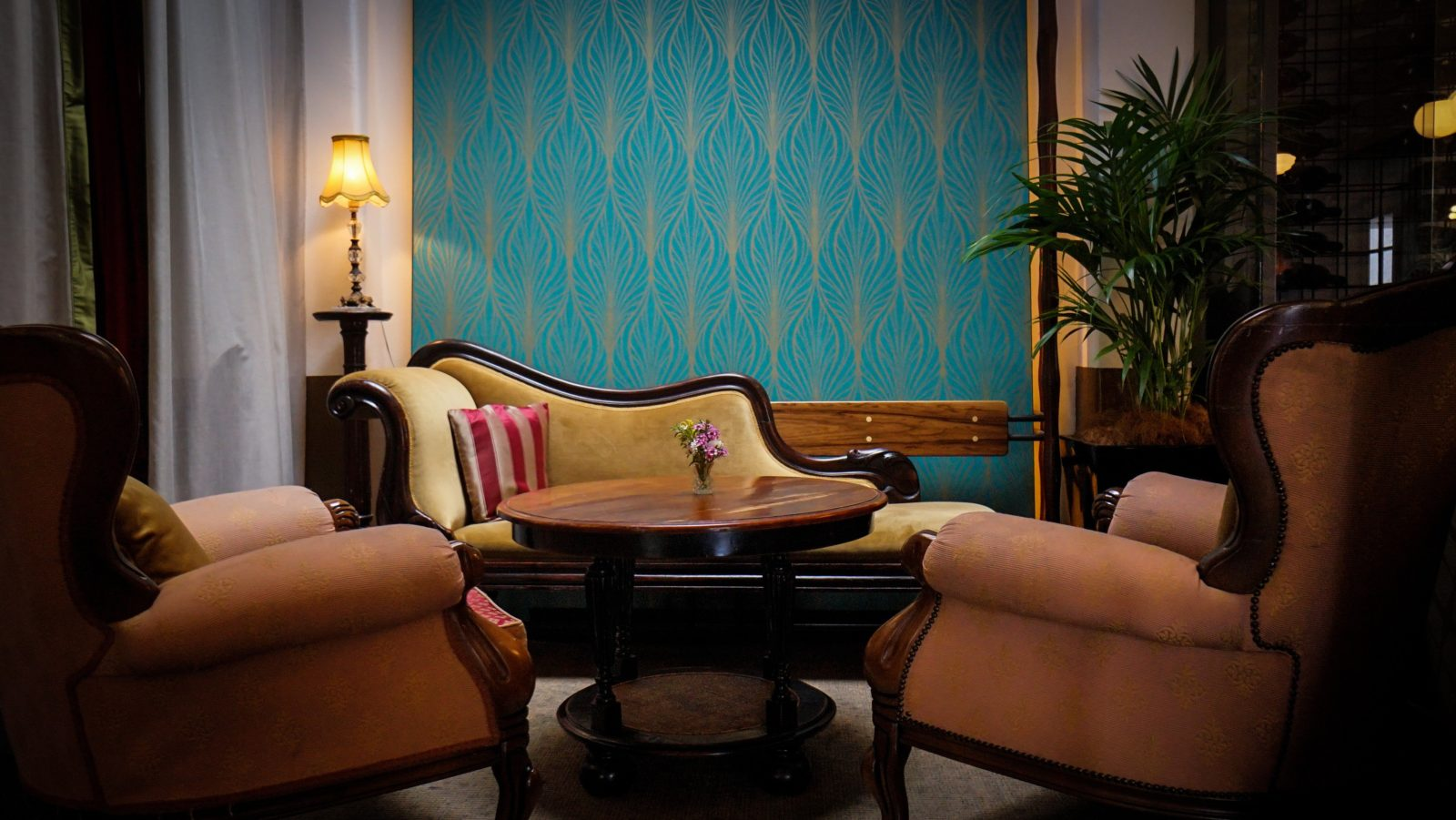 Art-Deco inspired lounges and shapely chesterfields adorn the bar area