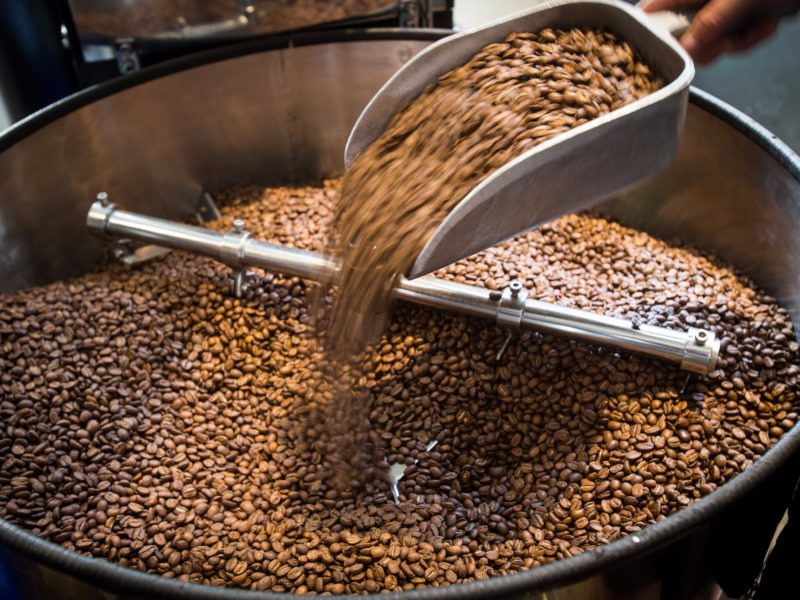 Coffee beans in a large grinder