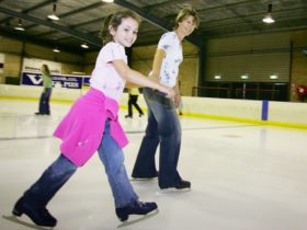 Mother and daugher ice skating