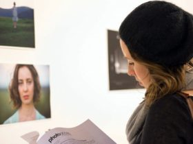 Exhibition visitor looking at the gallery notes