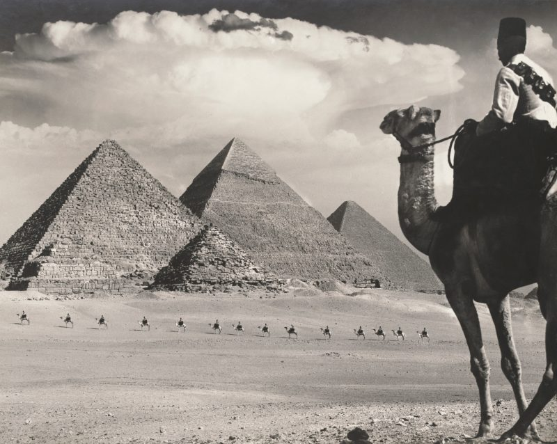 Frank Hurley, Cameleers in Front of the Pyramids of Gizeh, 1943, photographic print