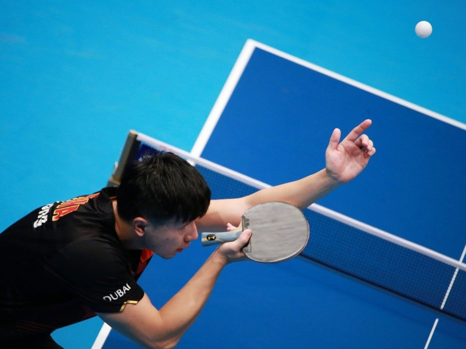 player playing ping pong