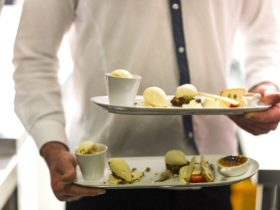 Waiter carrying Pistachio's desert tasting plate