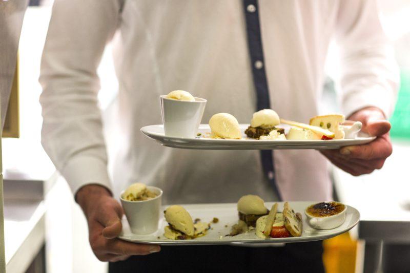 Waiter carrying Pistachio's desert tasting plate