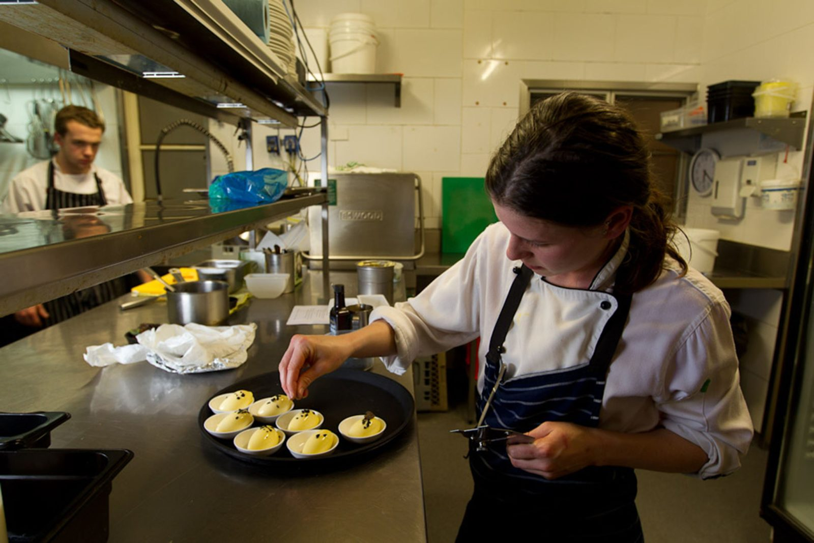 Chef preparing dish with truffle