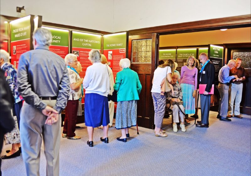 People viewing exhibition at inside the Church