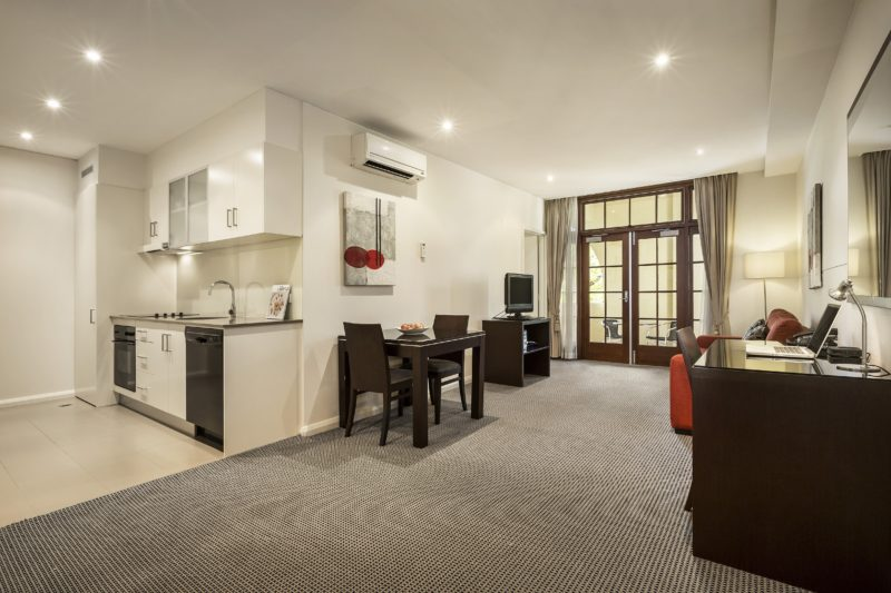 Interior view of a one bedroom executive room at Quest Canberra