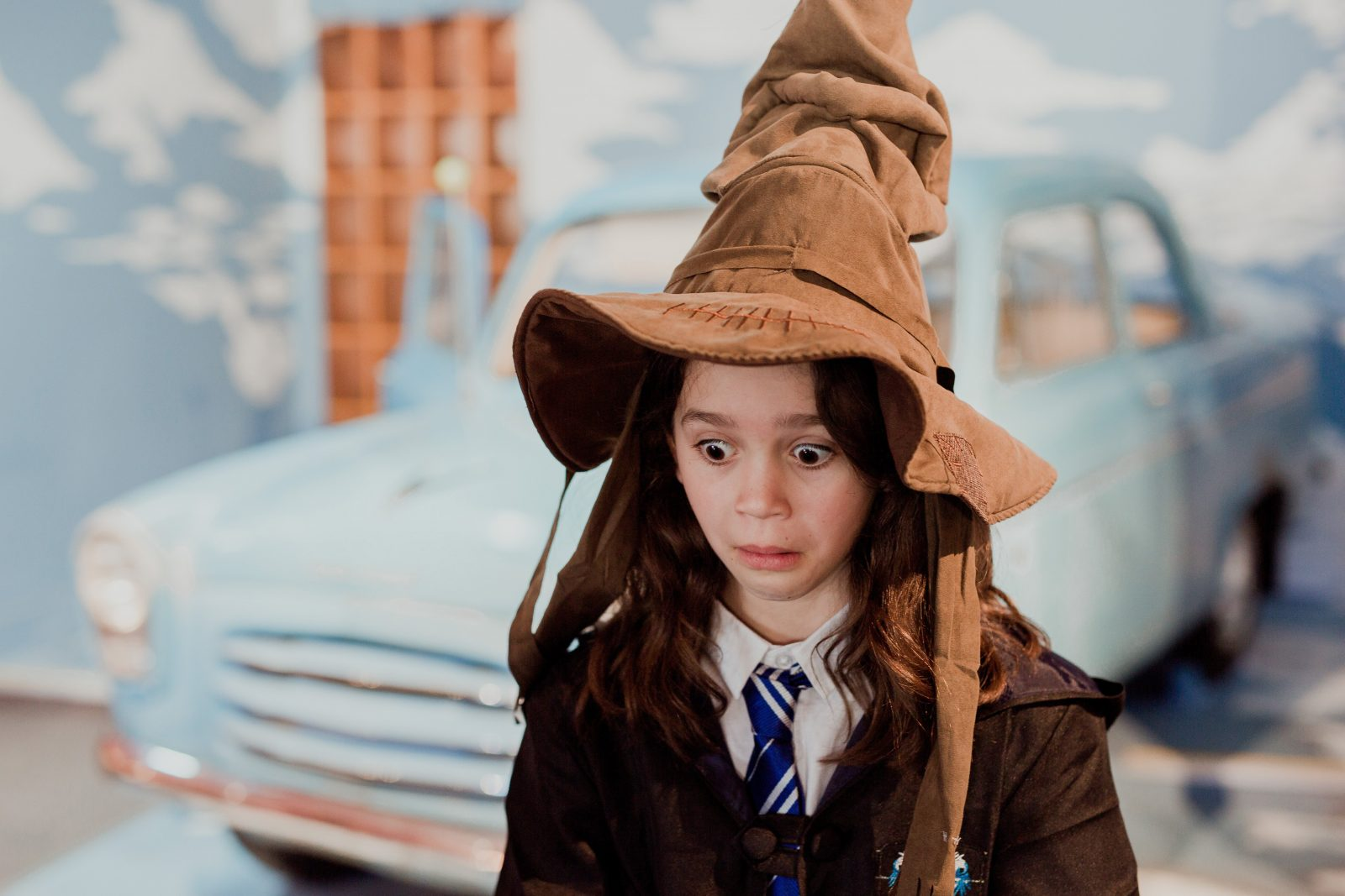 Young girl wearing a sorting hat