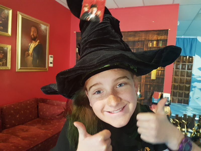 Young girl wearing a witch's hat
