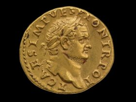 Gold coin (obverse) Head of Titus, laureate, with Latin inscription T CAES IMP VESP PON TR POT