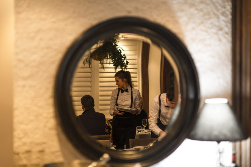 Wait staff images in a mirror