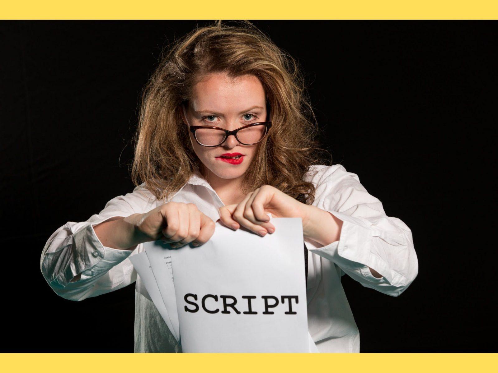 Woman tearing up a script
