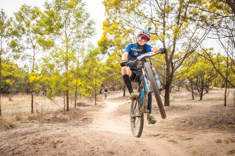 Endurance racing action at Stromlo Forest Park with Rocky Trail.
