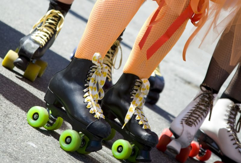Detail of feet of girls having fun on skates at Skate Nation in Canberra
