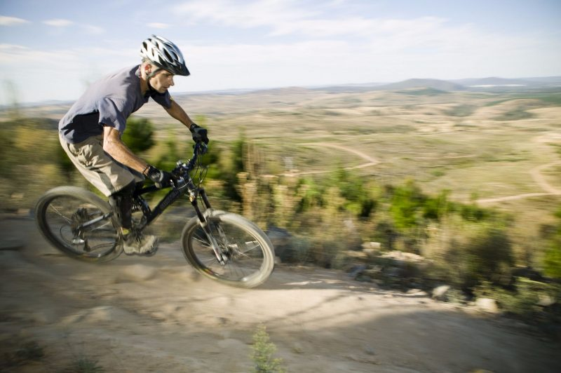 A man riding a mountain bike at Stromlo Forest Park