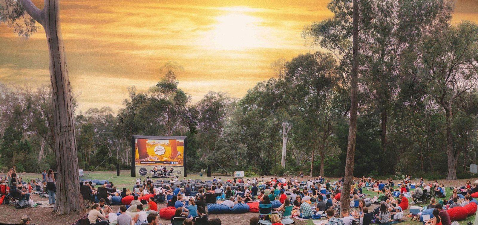 Crowd enjoying the beautiful setting sun priot to the screening of Sunset Cinema