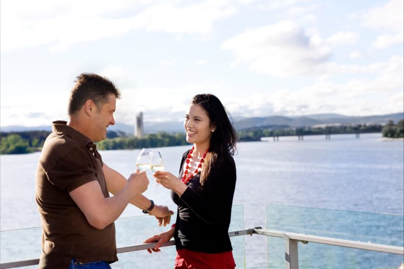 Couple enjoying wine and lake views