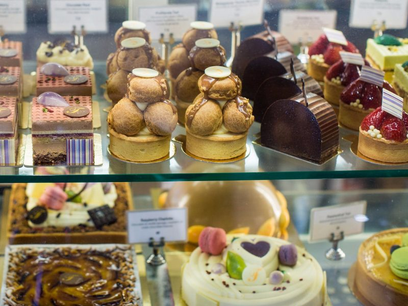 Display case of large and small cakes