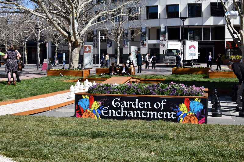 Garden of Enchantment in Garema Place. Grass, flowers, people