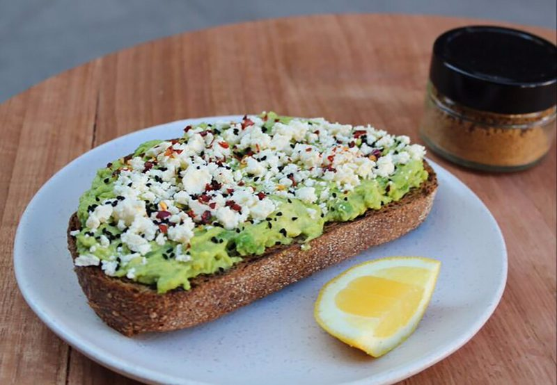 Avocado on toast with feta cheese and lemon