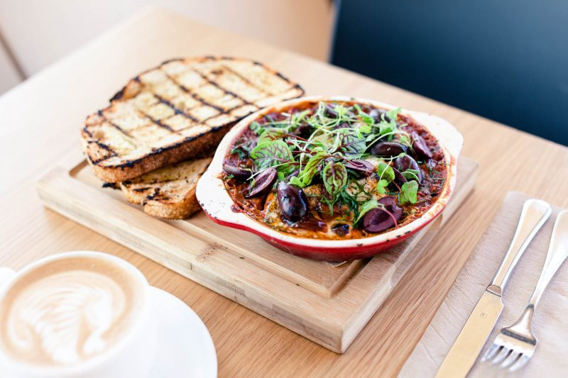 Baked eggs with chorizo, olive salsa, roasted tomato sauce & grilled sourdough