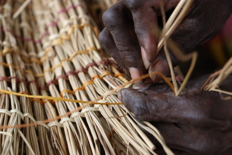 Hands making a basket