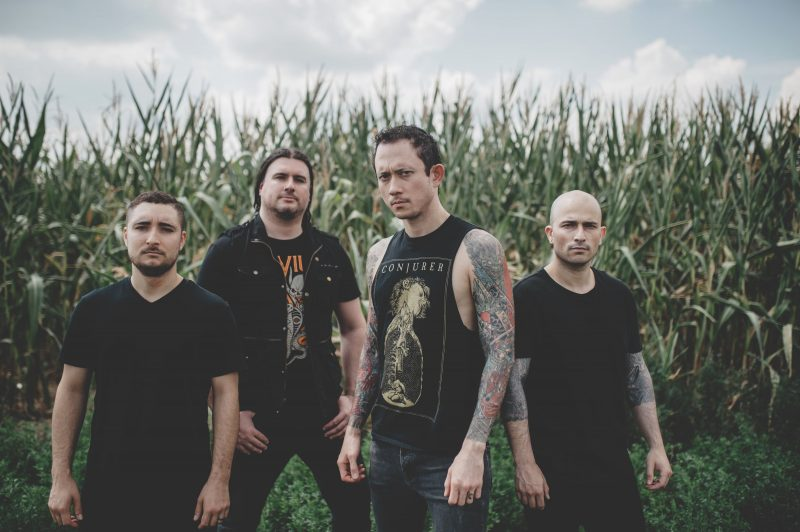 Photograph shows Trivium standing in field