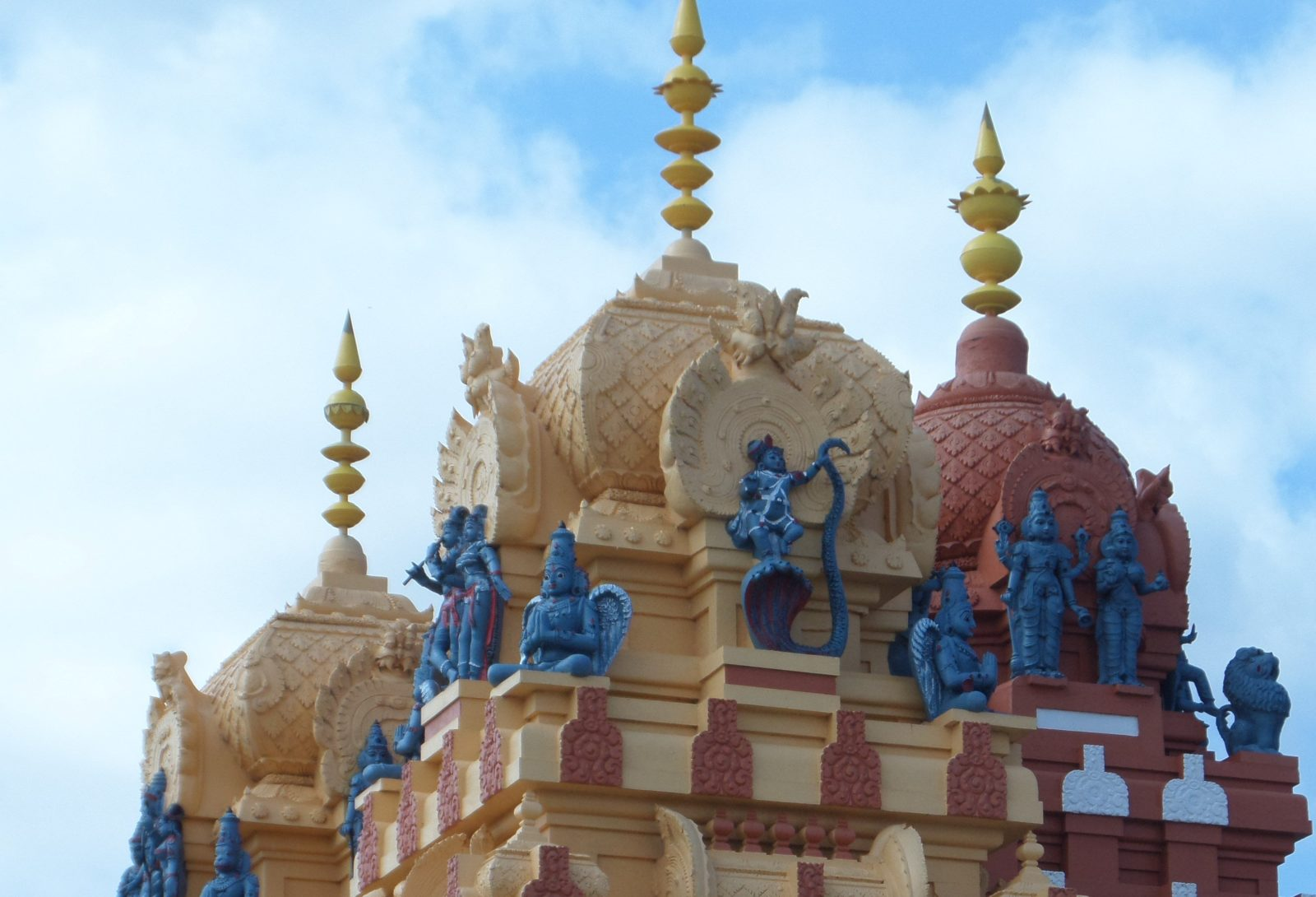 Statues and spires atop the Vishni Siva Mandir Temple and Library