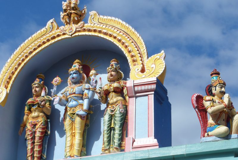 Statues on the roof of the Vishni Siva Mandir Temple and Library
