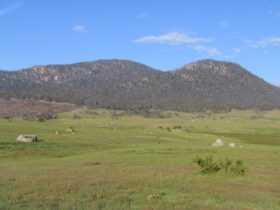 View of ranges with expansive grasslands in the foreground