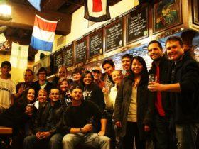 A small group, enjoying a craft ale, on The Sydney Pub Tour