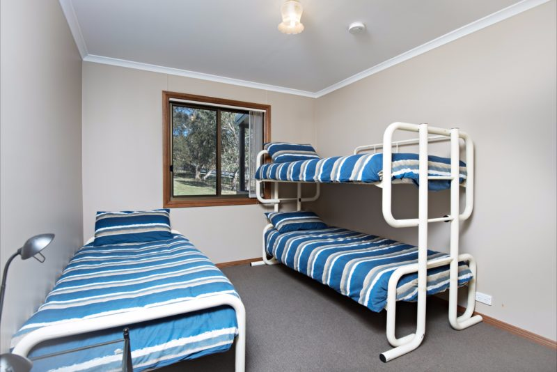 Bunk beds and single beds featured, fit for the whole family.