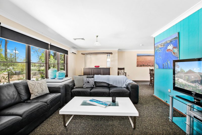 Main living room with big screen TV and Air-conditioning