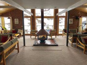 Lounge room with a view of the ski slopes