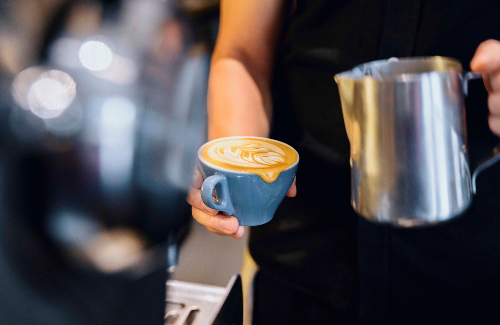 Barista making morning coffees at Artificer Cafe