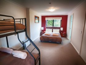 Bedroom with double bed plus tri-bunk