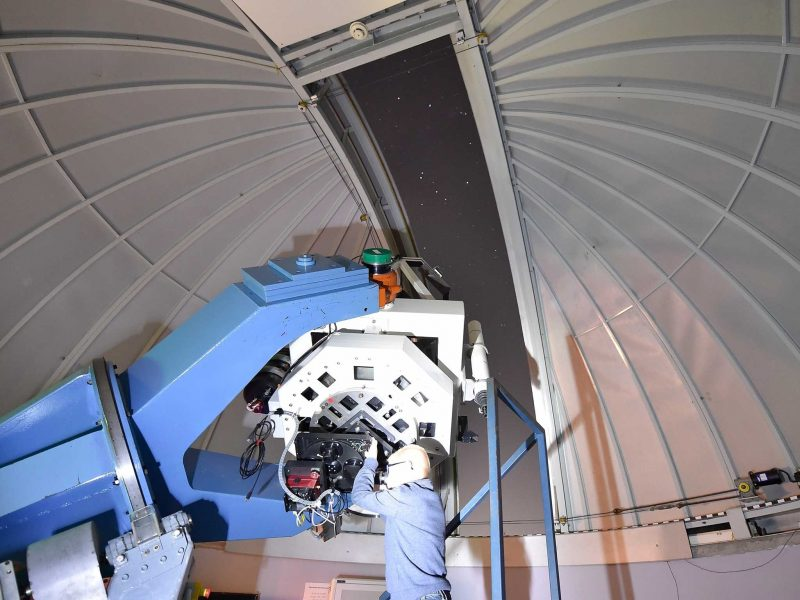 Telescope against dome roof of Observatory