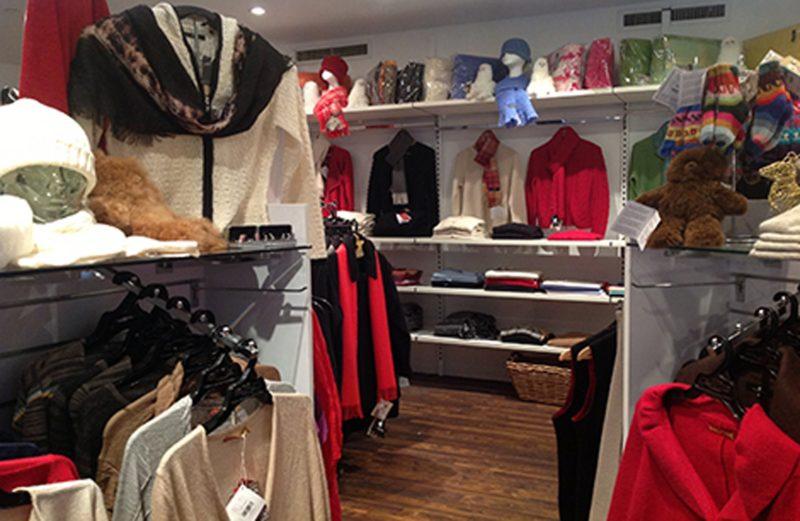 Inside Australian Alpaca Barn Rocks Store showing a collection of knitwear