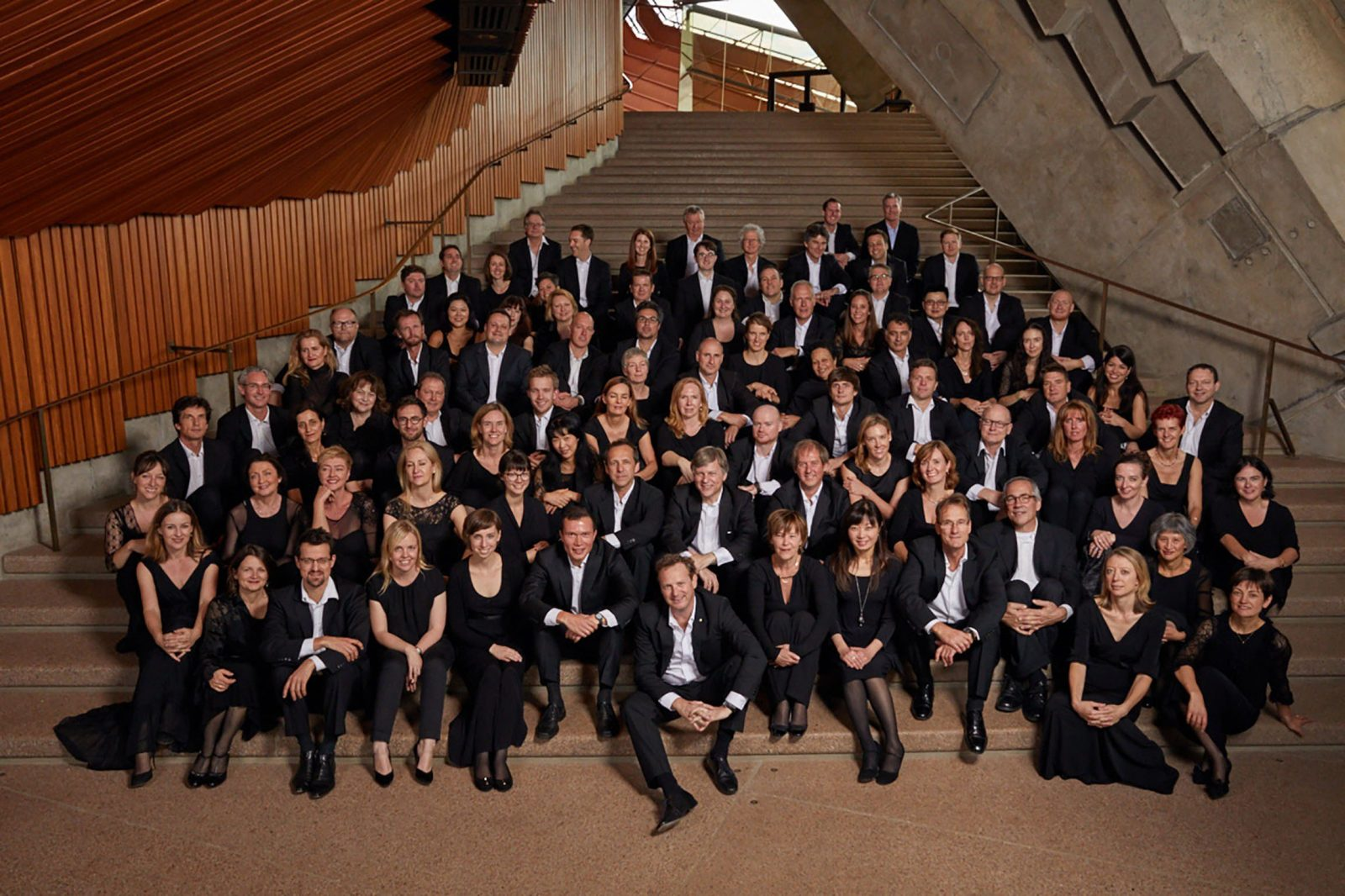 The Australian World Orchestra on the steps of the Sydney Opera House