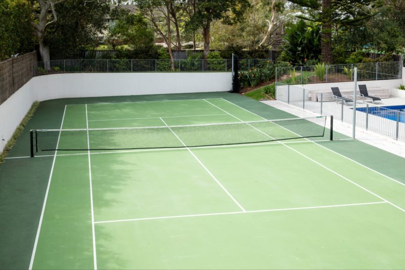 Tennis Court beside a swimming pool