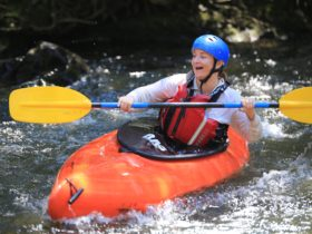 White water kayaking on the Barrington River with Barrington Outdoor Adventures