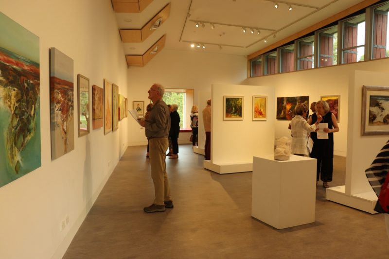 Photo of people looking at an exhibition