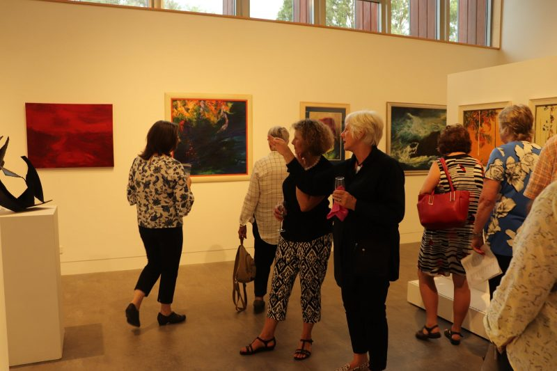 Photo of people at an exhibition