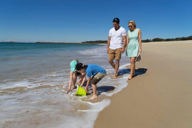 Family walking on Blacksmiths Beach